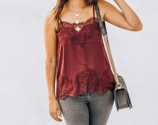 layered necklaces with burgundy lace cami