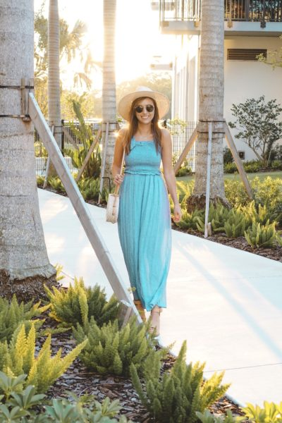 entourage clothing blue smocked jumpsuit with brixton hat