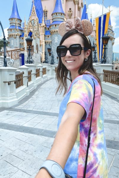 what to wear to Disney in the summer shein tie dye tshirt dress with gucci sunglasses at magical kingdom