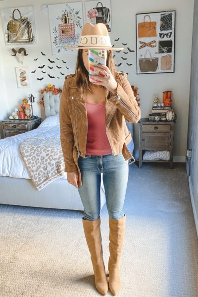 blanknyc suede moto jacket with pink top and knee high boots