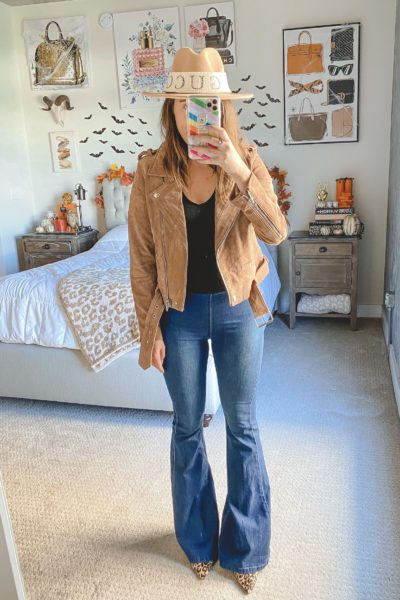 blanknyc suede moto jacket with flare jeans and fedora hat