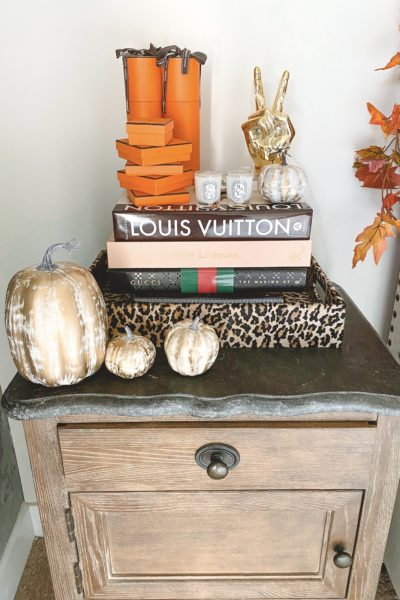 halloween bedroom decor leopard tray with pumpkins and hermes boxes on nightstand