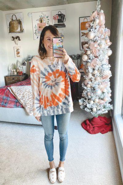 amazon orange tie dye sweatshirt with jeans and white mules