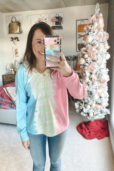 amazon tie dye sweatshirt with jeans and coin necklace