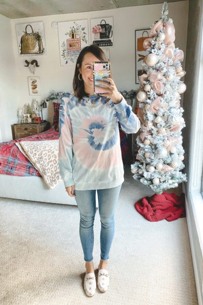 amazon pink and blue tie dye sweatshirt with jeans and white mules