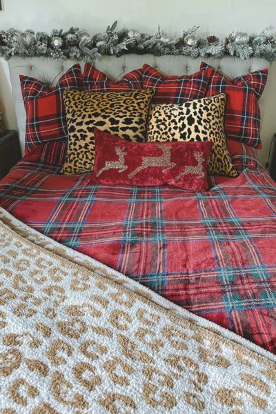 christmas bedroom decor 2020 with leopard pillows and plaid blanket