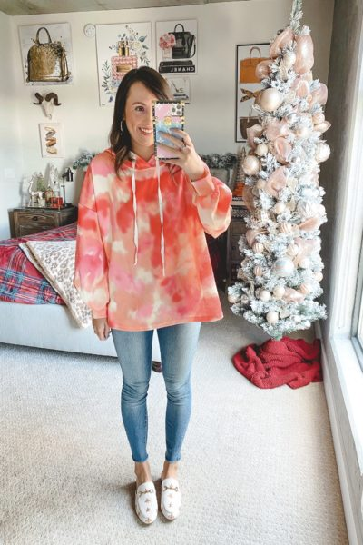 amazon orange tie dye sweatshirt with jeans and white mules