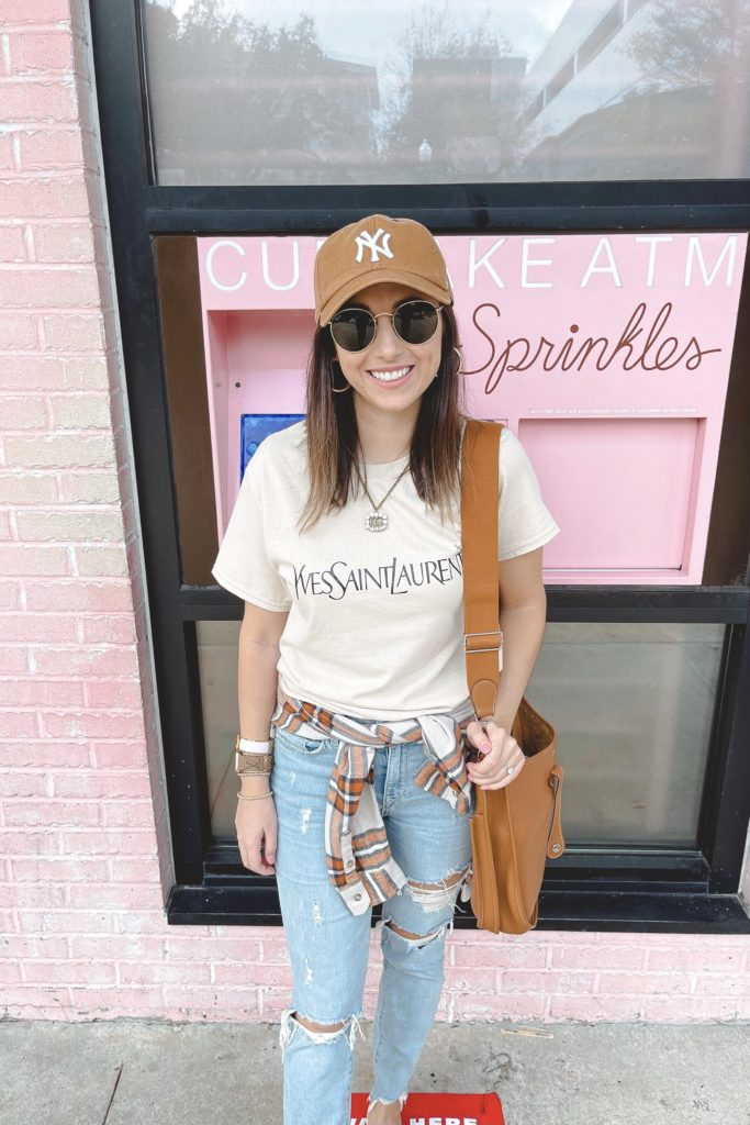 saint laurent tee with yankees hat and hermes evelyne