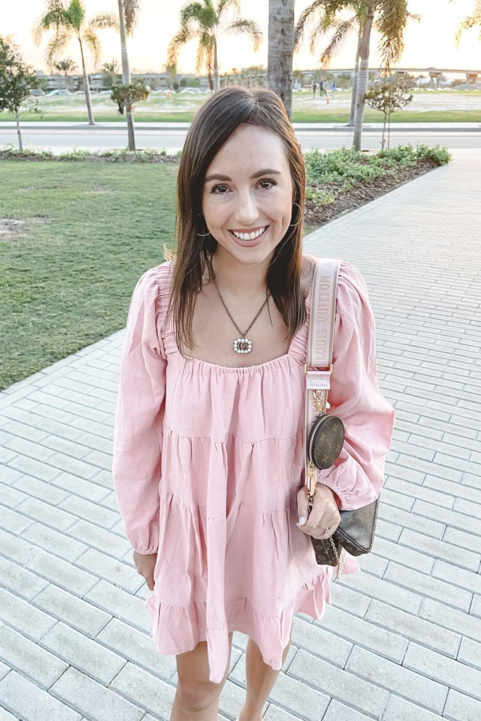 pink long sleeve dress with h sandals and louis vuitton multi pochette