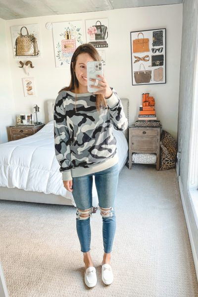 amazon camo sweatshirt with ripped jeans and mules