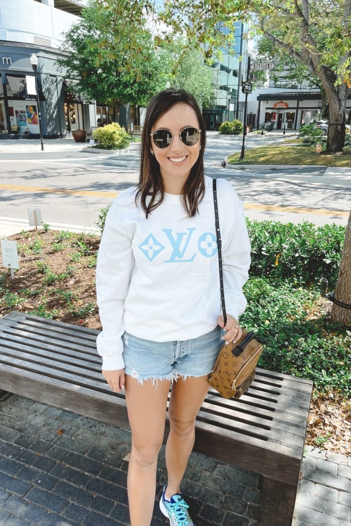 Louis vuitton inspired sweatshirt with agolde denim shorts and louis vuitton palm springs